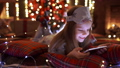 Girl playing with tablet, smartphone near Christmas tree 45803921