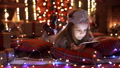 Girl playing with tablet, smartphone near Christmas tree 45803956