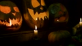 Video background for halloween. Three pumpkins with candles 45813326