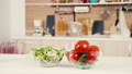 Two bowls with vegetables and salad on a table 45814915
