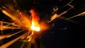 Sparkler Over Orange. Gun powder sparks shot against deep dark background. Burning fuse or bengal 45850394