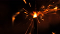 Bright sparks slowly fly from bright burning bengal light stick. Bengal fire macro view. Abstract 45850397