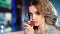 Close-up portrait of sexy woman drinking cocktail from glass having good time at luxury night party 45850956