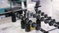 close view yellow liquid in bottle shaken by test appliance 45868526