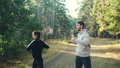 Beautiful couple is enjoying training outdoors in park doing exercises and smiling together wearing 45893238