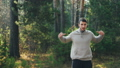 Good-looking bearded man is doing sports in park doing exercises for arms and body enjoying healthy 45893245