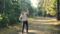 Sportsman is exercising in park warming-up arms, body and legs standing on path alone concentrated 45893247