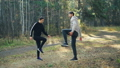 Happy couple is exercising in park doing warm-up activities smiling and talking enjoying fresh air 45893267