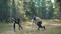 Young husband and wife are training in park together stretching legs on warm autumn day wearing 45893271