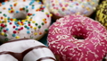 assorted donuts with different fillings and icing 45929832