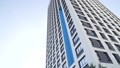 Looking up at a group of modern office buildings on blue sky background. Frame. Glass city buildings 45946646