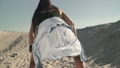 Young female dancing twerk at the beach Female with shirt tied at the waist Slow motion 45946679