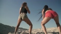 Young sexy girls with nice body dancing twerk at the beach Beautiful ladies dancing on the sand Hot 45946914