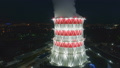 aerial motion around cooling tower at bright projector light 45969566