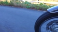 A video of a roadside shot taken by a sidecar over a touring wheel 45971552