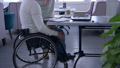 tutoring for invalid, successful senior crippled man in wheelchair with educator woman using smart 46011601