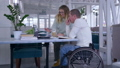 teaching for disabled, happy ill student senior male in wheelchair with educator woman during home 46011619