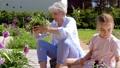 grandmother, granddaughter, flower 46062138