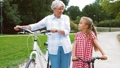 grandmother, granddaughter, bicycle 46063914