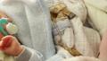Closeup little newborn baby girl 24 days sleeping 46072688