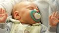 Closeup little newborn baby girl 24 days sleeping 46072693