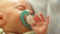 Closeup little newborn baby girl 24 days sleeping 46072694