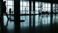 silhouettes of walking people on the background of glass 46148283
