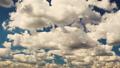 cumulonimbus clouds run across the blue sky 46148322