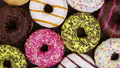 assorted donuts with different fillings and icing 46148327