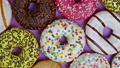 assorted donuts with different fillings and icing 46148328