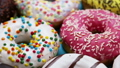assorted donuts with different fillings and icing 46148329