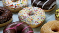 assorted donuts with different fillings and icing 46148330