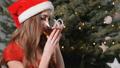 Girl Having Tea near Christmas Tree 46188172