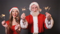 Santa and Helper Dance with Fireworks 46188180