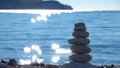 Zen Stones on beach for perfect meditation. Calm zen meditate background with rock pyramid on sand 46320836