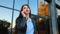 Business woman with smartphone close up near office building. Girl have conversation with cell phone 46379041