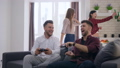 cheerful company friends playing video games have fun and drink beer at weekend in modern apartment 46399475