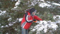 Attractive man sawing pine branches in his winter snowy garden for Merry Christmas and Happy New 46440182