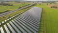 drone aerial of a solar power plant next to the highway in agricultural landscape 46460191