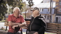Two retired grandfathers talking on street bench 46477070