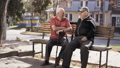 Pleasant talk of two aged friends on street bench 46477081