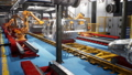 Car welding line of conveyor with frameworks of unfinished cars and robots welders 46492603