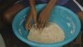 Preparing backing dough at Moresby local village 46503527