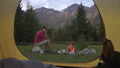 Man at camping with campfire and tent outdoors, slow motion. 46570860