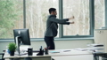 Handsome young man office worker is dancing in office and taking off jacket enjoying freedom and 46585015