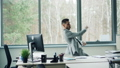 Good-looking bearded man in suit is dancing in office room alone moving body and arms then taking 46585426