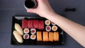 Sushi set nigiri and rolls on black plate 46594019