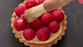 Unfinished to eat tartlet with custard raspberries 46594021