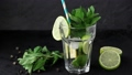 Pouring in glass Iced green tea with lime, lemon 46594025