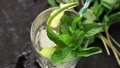 Pouring in glass Iced green tea with lime, lemon 46594026